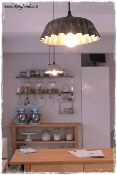 Making light fixtures from old bakeware. The gorgeous Salt Kitchen in Iceland...  http://www.skreytumhus.is/?p=16760