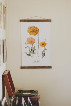 """""""The colors in this print are rich and go perfectly in my space. I love that the print is on canvas and hangs from wooden blocks--much more unique than a typical poster. I am thrilled with this purchase!"""" - Hannah K.  We are so happy you love Vol. 25's science posters as much as we do, Hannah!  <3"""