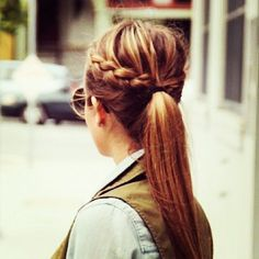 braided ponytail..If my hair would cooperate when I tried this then it would probably be pretty cute..