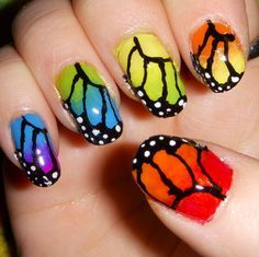 Butterfly Nail Art Ideas Check this amazing looking butterfly nail art design. Gradient colors of butterfly wings are painted on each of the nails. The thin black lines of the butterfly wings also work as a polka dot French tip which is just so creative. Rainbow Nail Art Designs, Butterfly Nail Designs, Butterfly Nail Art, Rainbow Butterfly, Butterfly Wings, Monarch Butterfly, Butterfly Pattern, Nail Designs 2014, Nail Polish Designs