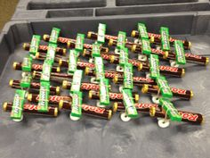 A fleet of Rolo airplanes. A pkg of stick gum for the wings, and Lifesaver wheels. Held together with a rubber band.