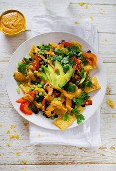 Black Bean Red Pepper & Avocado Nachos with Tortilla Chips, Red Onion + Vegan Spiced Potato Adobe Sauce Healthy Nachos, Healthy Superbowl Snacks, Vegan Nachos, Vegetarian Recipes, Healthy Recipes, Dip Recipes, Easy Recipes, Food For A Crowd, Fabulous Foods