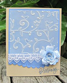 By Dawn Turley. Embossed vellum over cardstock. Note the punched edge on the blue cardstock panel, the lace, and the flower. Very pretty!