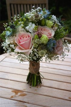 Romantic bridal bouquet styled with Sweet Avalanche by Meijer Roses, designed by Green Room Flowers