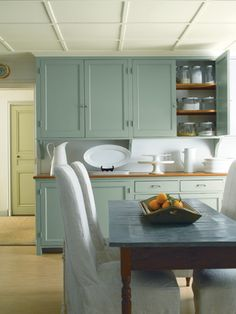 Loving the shade of paint on these kitchen cabinets.