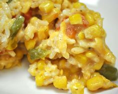 Sweet Corn and Rice Casserole  2 T Butter; 1 Green Bell Pepper & Onion, Chopped; 1 Can Mexicorn-Drained; 1 Can Sweet Corn- Drained; 1 Can Creamed Corn; 1 Can Rotel;  8 oz Mexican Velveeta- Cubed; 6 Cups Rice- Cooked; Salt & Pepper to Taste; 1/2 Cup Shredded Cheddar Cheese  Melt butter in pan.  Sauté peppers & onions. Add remaining ingredients except shredded cheese. Heat through. Place in casserole dish & top with shredded cheese. Bake at 350 for 30 minutes