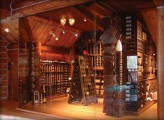This dramatic home cellar chose to use a wall of glass instead of walls, stone and brick to showcase the beautiful wine racks, New England wine cellar