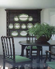 Forest Green  The intense green of these platters and seat cushions would overpower most other colors. But the rich brown of this furniture more than holds its own. Together, the two hues enhance each other, evoking the beauty of a forest. A bowl overflowing with ferns is a fitting woodland touch.