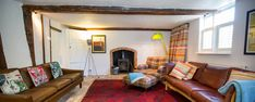 Sitting Room at Keep Cottage - with super comfy Mulberry Chair and modern mid century sofas.. oh and a swanky home cinema system