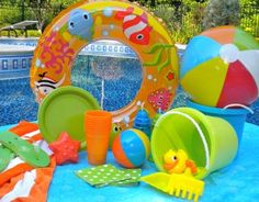 Use beach/pool toys for decorating your summer party.You can serve food using sand buckets and shovels.