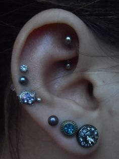 love this! triple lobe, triple helix and rook piercing.