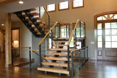 """White oak hardwood floors, 4"""" and 5"""" wide planks, site finished with Kona stain and a satin finish"""