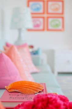 love the orange frames in the background House of Turquoise: Maria Barros + The Pink Pagoda
