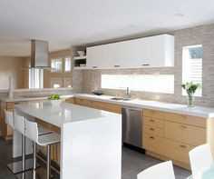 This kitchen features on the lower cabinets Kitchen Craft's natural White Oak eco-veneer and on the uppers satin White http://www.kitchencraftvancouver.com/