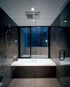 Dark Bathroom -  big wall tiles, wood structured brown floor tiles