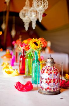 brightly colored vintage bottles as bud vases