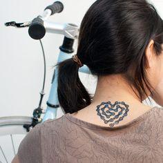 DESIGNED BY  JENNIFER DANIEL  Brooklyn, New York  NAME  HEART LINKS  PRICE  $5 (Set of 2)  via Tattly temporary tattoos  Ahhhh, I love this one!
