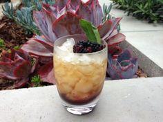 Blackberry-Sage Julep: 3 blackberries  2 sage leaves  1 sugar cube  Crushed ice  2 ounces bourbon    In a julep cup, muddle the blackberries, sage and sugar. Pack with crushed ice, pour the bourbon over the top and stir.
