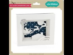 This is a tutorial on how to assemble Lori Whitlock's 5x7 Shadow Box Card. Santa and Reindeer Card SVG File: http://www.loriwhitlock.com/shop/5x7-sleigh-shad...