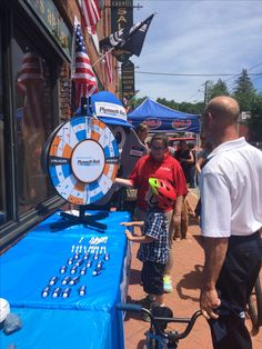 Plymouth Rock Assurance joined us at our Flag Day event, visitors could spin a wheel and win a prize! #FlagDay #FlagsFromParadisoIns