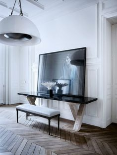 simple, wood floor, details, art, photography, lighting, fixture, bench, hallway style, vignette, black and white, modern, parquet floor, white walls from: Parisian Interior by Gilles Et Boissier | Trendland: Design Blog & Trend Magazine