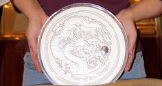 Person Holding A Real 10 Kilo #Silver Coin. http://www.gainesvillecoins.com/buy-silver.aspx