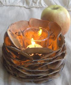 In LOVE with this idea!!! Could simmer pinecones in cinnamon stick water beforehand, let dry and when warmed with the candle will also be an air freshener <3