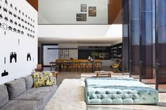 Studio Guilherme Torres designed the LA House for a young couple who wanted to eliminate the small spaces and the traditional partitions in their existing 4,400 sq ft (410 sq m) condominium in Londrina, Brazil.
