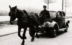 During German occupation of The Netherlands people used cars without gas because of shortages. In this photo a Ford V* is drawn by a horse. The spot that usually holds the engine is being used as the drivers' seat. Holland, The Hague, may 1941 World History, World War Ii, History Pics, Automobile, La Haye, Ford V8, Horse Drawn, Interesting History, Vintage Photography