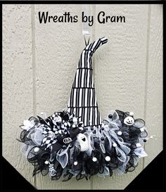 Black and white halloween decor; beetlejuice aesthetic; white pumpkins; Tim Burton aesthetic;  black and white aesthetic; witch hat wreath;  halloween aesthetic; halloween decorations; October birthday ideas; goth aesthetic; cute halloween decorations; witches hat wreath; cheer up gifts; farmhouse halloween decor; entryway halloween decorations; halloween wall decor; gothic home decor; halloween home decor #beetlejuice #halloween #wreaths #blackandwhite #goth