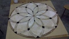 "A 48"" round waterjet mural of travertine and marble."