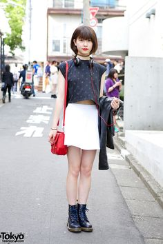 [Pretty and Cute!] Yuka's geometric print crop top is from i tokyo me, worn with a mini skirt from American Apparel and a leather jacket from Lowrys Farm. She accessorized with a Bubbles tattoo necklace, Beats SoloHD headphones, a red satchel, a ring and Dr. Martens boots. #Harajuku