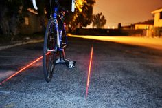 XFire Bike Safety Light - Make your nighttime bike rides more safe with the XFire Bike Lane Safety Light. The glowing LED light attachment shoots out two laser beams of ligh. Bicycle Safety, Cool Inventions, Bike Frame, Light Project, Cool Tech, Tail Light, Night Time, Cool Stuff, Interesting Stuff