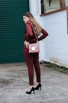 Maristella wears a blouse, pants and bag from Purificacion Garcia, Zara pumps