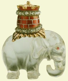Elephant and Castle | Elephant and Castle, the elephant of carved rock crystal with cabochon ruby eyes; it bears a castle on its back of yellow and red gold enamel with translucent rust-coloured enamel bricks, set with rose diamonds, a red-gold rug beneath. This is the badge of the Danish Order of the Elephant.