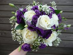 Large white rose, purple lisianthus, gypsophila and ruscus -maybe a little less baby's breath and a little more lisianthus