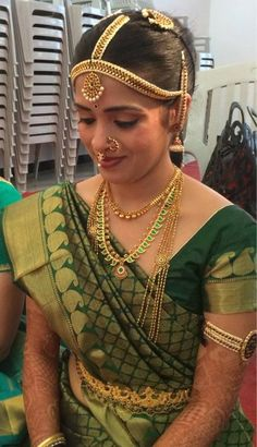 Traditional South Indian Iyer bride wearing bridal saree and jewellery. Muhurat look: