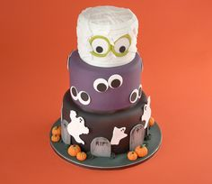 Halloween cake - Bake and decorate a cake for Halloween with a mummy, ghosts, pumpkins and graves using Ready to Roll Icing