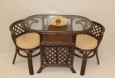 Borneo Compact Dining SET Table+2 Chairs Dark Brown Handmade Natural Wicker Rattan Furniture  This is a great looking eco-friendly set that you will enjoy for years. It combines a sustainable rattan frame with exclusive rattan weaving. The comfortable cushion as shown provides you with great support.   Chair Dimensions:  27.5 H x 20 W x 19.3 D   Table Dimensions:  30 H x 40 W x 20.1 D   Dimensions of the set when chairs are tucked in:  30 H x 40 W x 20.2 D   Set consists of:  2 chair..