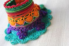Lagerstroemia Speciosa : beaded crochet cuff with orange, red, purple, turquoise blue and emerald green beaded flowers and crocheted lace by irregular expressions