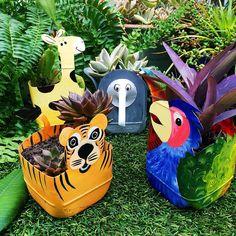 Milk jug jungle planters by Milk jug jungle planters by bottle crafts diy Plastic Milk Bottles, Plastic Bottle Planter, Plastic Bottle Crafts, Milk Jugs, Plastic Art, Garden Crafts, Garden Art, Recycled Crafts, Diy And Crafts