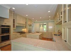 cream kitchen / light wood floor