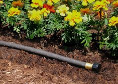 Tuck a soaker hose in your garden bed, cover with mulch and attach to a hose timer for an efficient watering solution all summer long. Check out more garden hose info at The Home Depot's Garden Club.