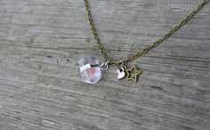 Clear quartz hexagonal necklace  reiki healing * Quartz i is the most recognized type of crystal. In fact, many people envision quartz crystals when they think of crystals, even though there are many different types of crystals. Quartz can be icy clear or have inclusions, veils, bubbles, and various colors. Visual clarity normally isn't important to a quartz's energetic quality and ability to amplify subtle energies.