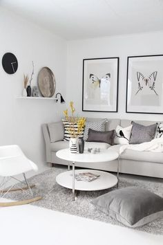 I'm really loving the Scandinavian look lately...lots of white with black & gray accents and sometimes a pop of neon somewhere...but I especially love this living space...the b striped pillow...the framed huge butterflies of course and the gorgeous pop of yellow from the flowers.