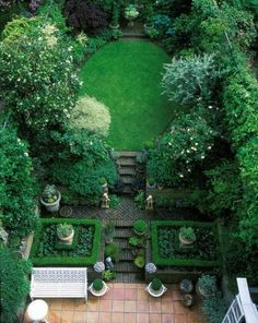 Parterre courtyard garden with oval lawn. So pretty.