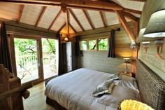 The LuxPad | Glamping Retreats in Europe! A luxury cabin with wooden beams and a jungle view!
