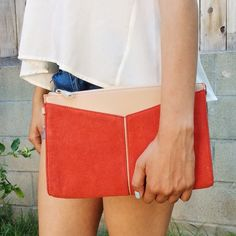 """Sale $40 BCBGMaxAzria Leather Suede Angled Clutch BCBGMaxAzria lipstick red angled pocket clutch. Cow leather exterior with faux leather trim. It's sleek color-blocked exterior offers a polished go-anywhere wristlet that perfectly complements your on-the-go style.  Detachable wristlet strap. 7.5"""" W.    11"""" H.     1.25"""" D. Smooth, color-blocked exterior with topstitching. Interior zipper pocket, two slip pockets. Top zipper closure. NWT BCBGMaxAzria Bags Clutches & Wristlets"""