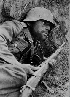 """kruegerwaffen: """"  A weary German soldier has taken cover during combat at the Eastern Front. """""""