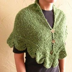 green triangle shawl with buttons and leaf border